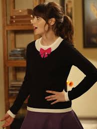 zooey deschanel new girl fashion wwzdw what would zooey deschanel s black bow sweater and purple skirt on new girl