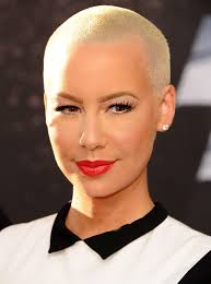 pixie haircut for strong faces while it might not be called a pixie amber rose s tight crop is
