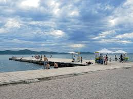 sea organ croatia lazy summer day at the pier on the riva in zadar croatia