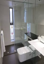 white modern bathroom vintage fixtures high end plumbing floor