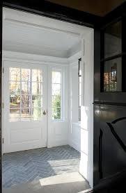 mudroom floor ideas mudroom with slate herringbone tiled floor transitional