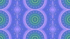 decorative ornamental snowflakes fall against a blue motion