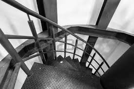 round stairs an in old industrial factory windows stock photo