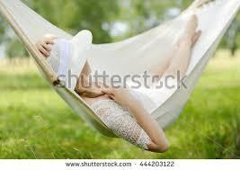 woman resting hammock outdoors caucasian woman stock photo