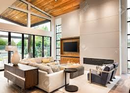 living room interior with hardwood floors vaulted ceiling and