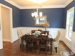 traditional dining room with crown molding by sandra