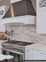 backsplash for white kitchen cabinets espresso brown kichen cabinets white countertop gray mosaic