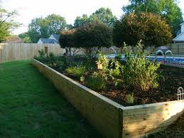 selecting materials for your retaining wall in your garden wooden