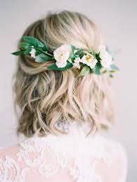 bridal hair flowers hair bridal hairstyle with half flower crown and greenery by