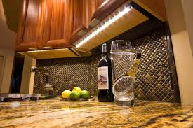 classic kitchen with white led fluorescent under cabinet lighting