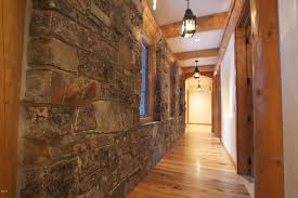 rustic hallway with exposed beam hardwood floors in whitefish