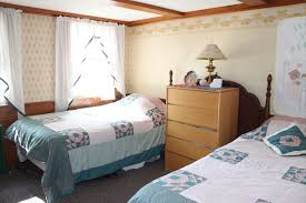 Guest Room With Twin Beds by White Trellis Motel Guest Rooms