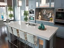 white wooden kitchen island with grey wooden kitchen cabinet and