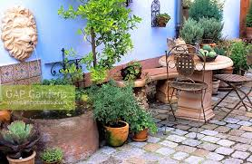 gap gardens mediterranean garden room with terracotta ornaments