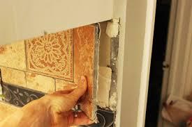 how to remove a kitchen tile backsplash remove tile by tile