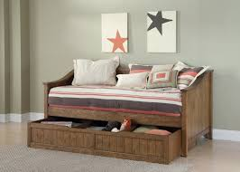 rustic family room with brown wooden daybed storage drawer and