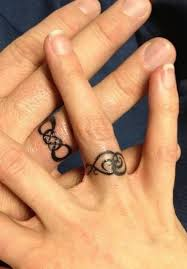 weddings rings designs images Sweet wedding ring tattoos jpg