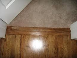 low pile carpeting recessed into wood floors completes barrier