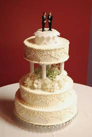 everything is frosted traditional wedding cake with pillars and