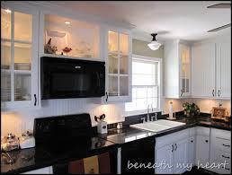 glass shelf between kitchen cabinets kitchen cabinets design dilemma the frugal homemaker
