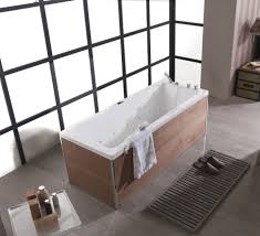 simple free standing rectangular bathtub design on wooden floor