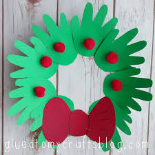 a christmas wreath made out of cardstock handprints a paper