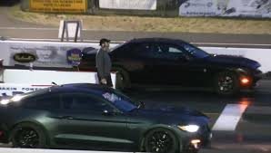 dodge challenger vs mustang gt challenger hellcat vs supercharged 2017 mustang gt drag race is a