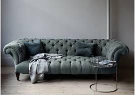velvet tufted sofa blue and white pillows fluffy comfy blue