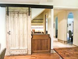 Under Stairs Pantry by Bar Under Stairs With Sliding Barn Door To Cover Basement