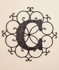 single initial steel monogram with wrought iron inspired scroll