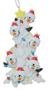 resin penguin family of 6 christmas ornaments with white tree as