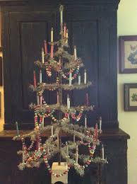 feather tree with glass chains and glass candle lights ornaments