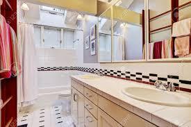 bright bathroom interior with tile wall trim white bath tub