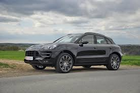 porsche macan black black turbo with the black exterior package and 21s and beige