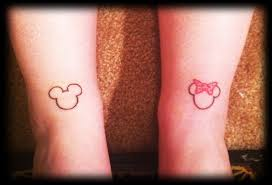 attractive red color ink mickey u0026 minnie couple tattoo design for