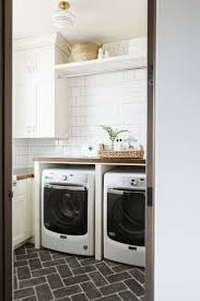 84 best laundry service images on pinterest laundry room with subway tile cobblestone herringbone floors and butcher block counter top