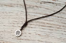 cord pendant necklace images Prasada jewelry mini unisex om pendant necklace brown cord jpg