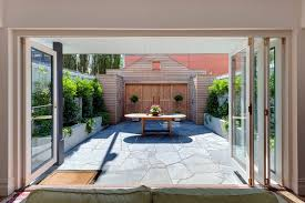 paved courtyard garden ideas patio rustic with timber doors