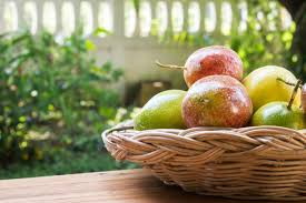 fruit in a basket fruit in a basket on wood background photo premium