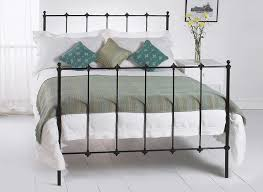 bedroom paris metal bed frame with flower vases and white walls