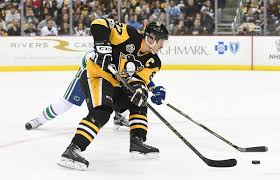 sidney crosby records 1 000th career point versus jets