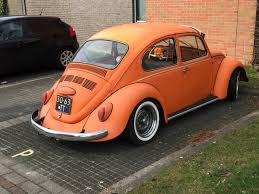 orange volkswagen beetle spotted volkswagen beetle