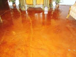 clean salmon painting a concrete flooring with contemporary home