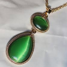 cat eye pendant necklace images Witches of east end joanna necklace party jewelry green cat 39 s eye jpg