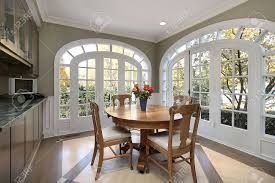 eating area in luxury home with circular windows stock photo