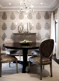 white and gray dining room with worlds away leona silver leaf
