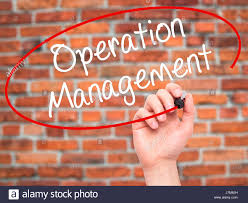 man hand writing operation management with black marker on visual
