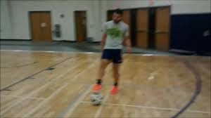 guy kicks soccer ball into basketball hoop jukin media