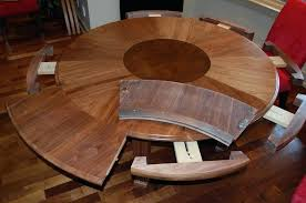 expanding round dining room table video extending nz extendable