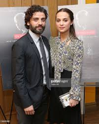 actors oscar isaac and alicia vikander attend the ex machina new york picture id468761096